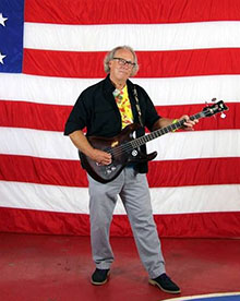 Craig Bell in front of an American flag.